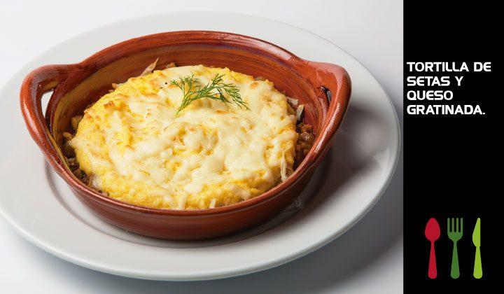Tortilla de setas y queso gratinada.